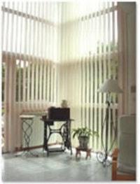 Store à bandes verticales orientables - Batiweb