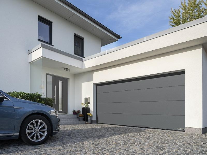 Porte de garage sectionnelle motorisée RenoMatic avec motorisation ProMatic 4 de série - Batiweb
