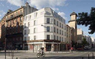 TECHNAL HABILLE DE 12 MENUISERIES SUR-MESURE VEC LA SURÉLÉVATION D'UN IMMEUBLE DE LOGEMENTS SOCIAUX À PARIS
