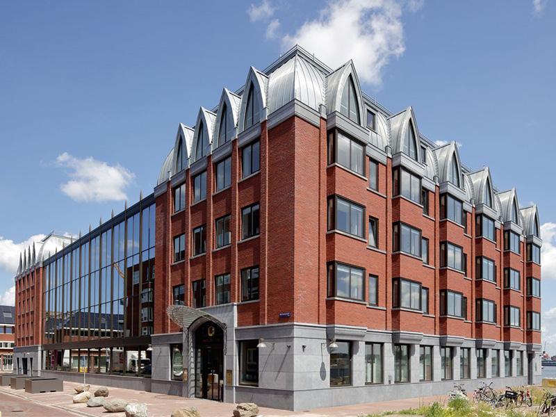 RHEINZINK allie tradition et modernité dans un quartier historique d'Amsterdam - Batiweb
